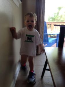 T sporting his Moms Little Running Buddy Shirt and Daddy's Running Shoes
