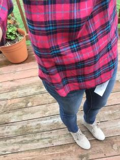 close up of flannel, jeans boots