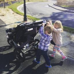 kids-pushing-stroller